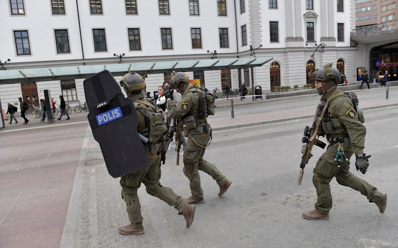 Armed police officers outside Stockholm's central station - Credit: TT News Agency /Reuters