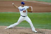 Los Angeles Dodgers relief pitcher Blake Treinen throws against the Atlanta Braves during the seventh inning in Game 6 of a baseball National League Championship Series Saturday, Oct. 17, 2020, in Arlington, Texas. (AP Photo/Tony Gutierrez)