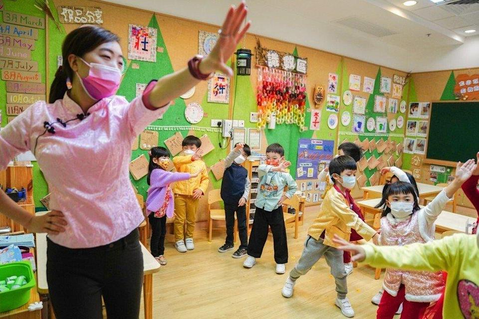 Children get back into the swing of things at Ling Liang Church Sau Tak Kindergarten in Lai Chi Kok. Photo: Sam Tsang