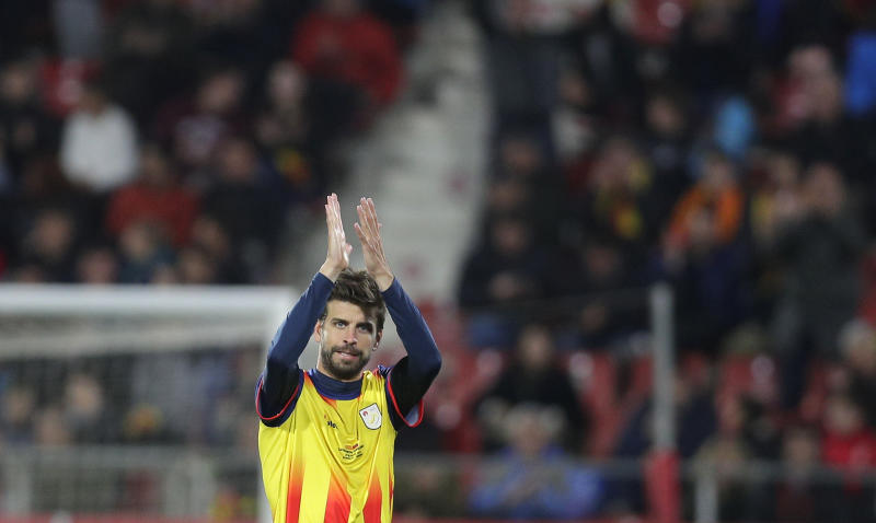 Catalonia's Gerard Pique applauds after being substituted during a friendly soccer match between Catalonia and Venezuela at the Montilivi stadium in Girona, Spain, Monday, March 25, 2019. (AP Photo/Manu Fernandez)