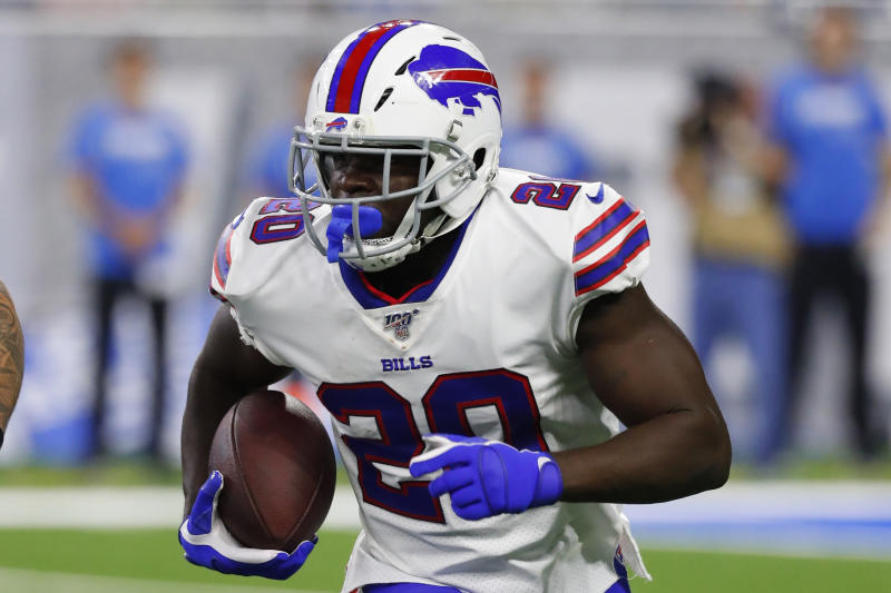 FILE - In this Aug. 23, 2019, file photo, Buffalo Bills running back Frank Gore (20) runs the ball in the first half of an NFL preseason football game against the Detroit Lions in Detroit. Gore 88 yards on Sunday against the New England Patriots to push him over 15,000 career yards rushing. (AP Photo/Rick Osentoski, File)