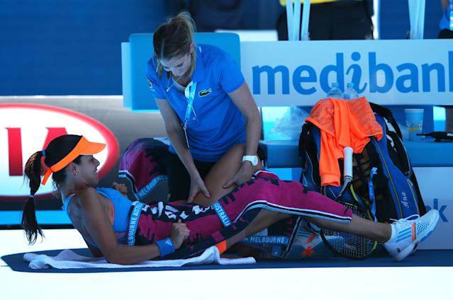 MELBOURNE, AUSTRALIA - JANUARY 21: Ana Ivanovic of Serbia receives medical attention in her quarterfinal match against Eugenie Bouchard of Canada during day nine of the 2014 Australian Open at Melbourne Park on January 21, 2014 in Melbourne, Australia. (Photo by Mark Kolbe/Getty Images)