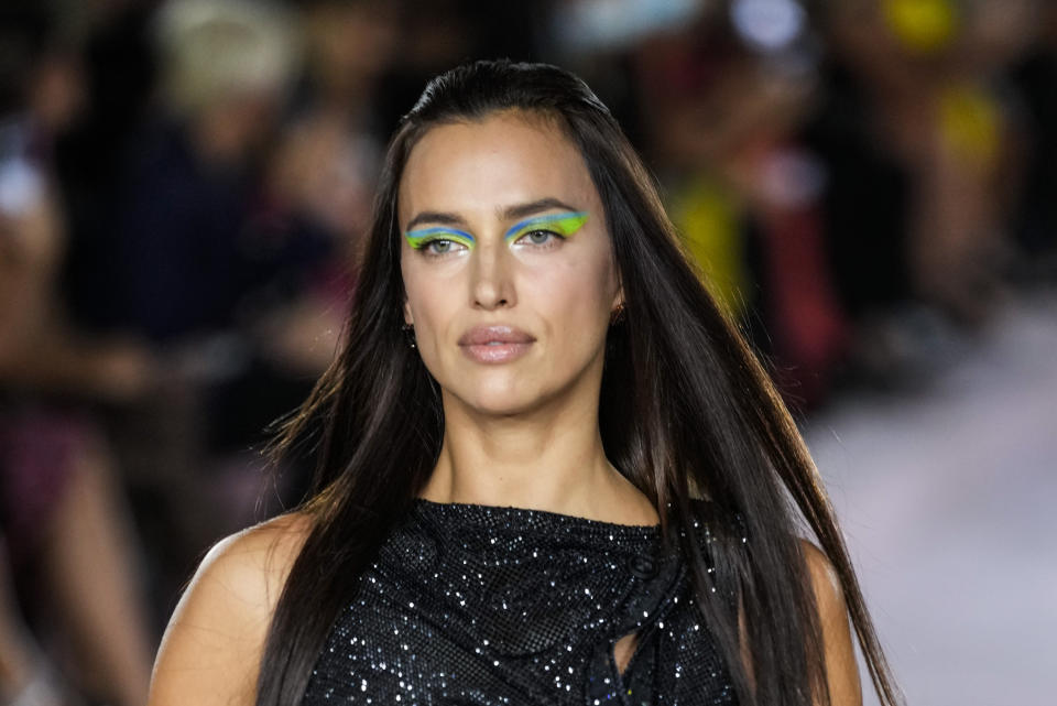 Irina Shayk wears a creation for the Versace Spring Summer 2022 collection during Milan Fashion Week, in Milan, Italy, Friday, Sept. 24, 2021. (AP Photo/Luca Bruno)