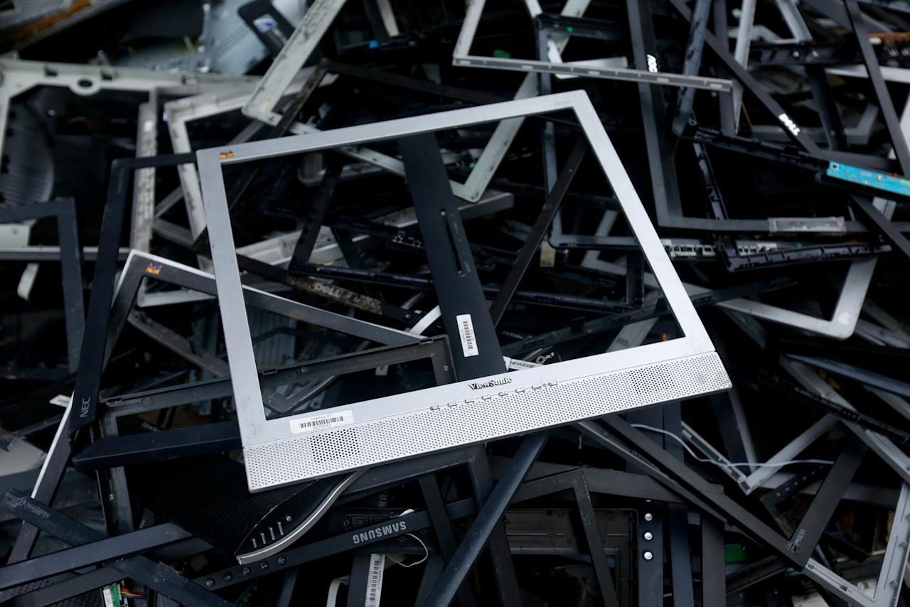 Computer screen frames to be recycled, are piled-up outside an electronic shop in Karachi, Pakistan October 17, 2017. REUTERS/Akhtar Soomro