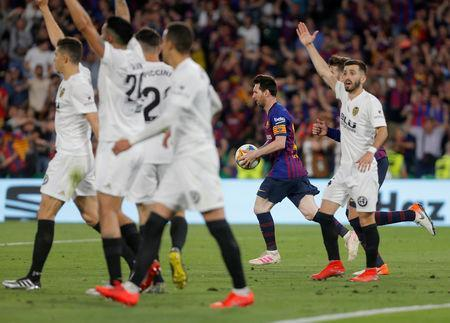 Soccer Football - Copa del Rey - Final - FC Barcelona v Valencia - Estadio Benito Villamarin, Seville, Spain - May 25, 2019 Barcelona's Lionel Messi celebrates scoring their first goal REUTERS/Jon Nazca