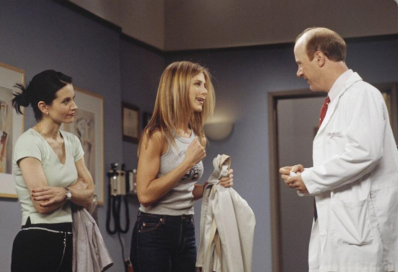 FRIENDS -- 'The One with Joey's Big Break' Episode 22 -- Pictured: (l-r) Courteney Cox as Monica Geller, Jennifer Aniston as Rachel Greene, Michael Monks as Dr. Miller (Photo by Paul Drinkwater/NBC/NBCU Photo Bank via Getty Images)