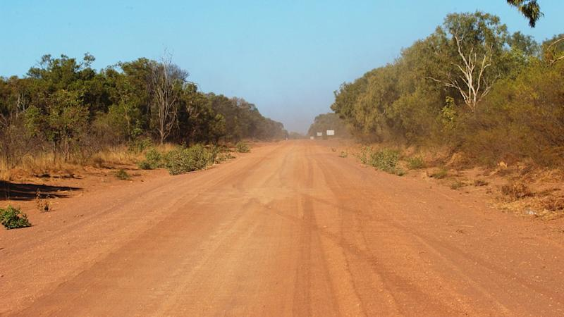 Three men were found dead in outback Queensland near the Northern Territory border. Pictured is a stock image of dirt highway.