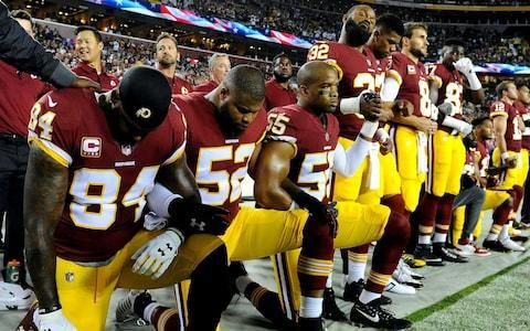 "Donald Trump has suggested American football players who refuse to stand for the national anthem ""shouldn't be in the country"". The National Football League (NFL) owners voted unanimously to approve a new rule to fine clubs whose players kneel during the Star Spangled Banner on Wednesday. In an interview with Fox News morning show Fox & Friends, Mr Trump said: ""You have to stand proudly for the national anthem [or] you shouldn't be playing, you shouldn't be there. Maybe they shouldn't be in the country."" NFL players have been protesting against police brutality and racial injustice by kneeling during the pre-match national anthem since 2016. Under the new rule, players who do not wish to stand for the anthem must remain in the locker room while the anthem is played - or face an unspecified fine. ""I don't think people should be staying in the locker rooms, but still I think it's good,"" Mr Trump said in his first statements since the announcement. ""You have to stand proudly for the National Anthem and the NFL owners did the right thing with that if that's what they've done."" Mr Trump has previously called for protesting players to be fired, calling the decision a ""total disrespect of our heritage"". Players will now have to remain in the locker room if they do not wish to stand Credit: USA Today Sports News of the fine has been met with fierce criticism in some quarters. In Thursday's editorial, the New York Times accused the NFL of capitulating ""to a president who relishes demonising black athletes"". The owner of the New York Jets said he would allow his players to continue to protest on the pitch. ""If somebody takes a knee, that fine will be borne by the organisation, by me, not the players,"" Christopher Johnson told Newsday. ""I never want to put restrictions on the speech of our players."" Colin Kaepernick, the player who started the movement in August 2016, was named GQ's 'Citizen of the Year' in 2017 and was a runner up for Time's 'Person of the Year'. Colin Kaepernick's protest has split opinion Credit: Orlando Jorge Ramirez / USA Today Critics claim that the protest is a mark of disrespect to the American flag and to the military service men and women who defend it. Accepting an Amnesty International award last month, Kaepernick said: ""While taking a knee is a physical display that challenges the merits of who is excluded from the notion of freedom, liberty, and justice for all, the protest is also rooted in a convergence of my moralistic beliefs, and my love for the people."""