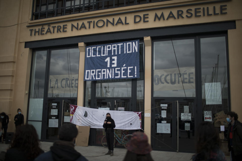 Culture workers, actors, students, and theater employees attend a general assembly at the occupied Theatre de La Criee in Marseille, southern France, Friday, March 25, 2021. Out-of-work French culture and tourism workers are occupying theaters accross France to demand more government support after a year of pandemic that has devastated their incomes and put their livelihoods on indefinite hold. (AP Photo/Daniel Cole)