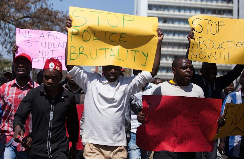 Zimbabwe Opposition Party Movement for Democratic Change Tsvangirai faction (MDC-T) supporters take part in a march against police brutality in Harare on August 24, 2016