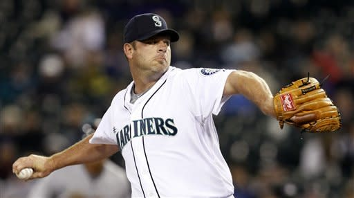 Seattle Mariners starting pitcher Kevin Millwood throws to the Cleveland Indians in the first inning of a baseball game Tuesday, April 17, 2012, in Seattle. (AP Photo/Elaine Thompson)