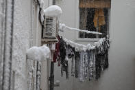 "Frozen laundry hangs on a line outside an apartment window after a heavy snowfall in Madrid, Spain, Saturday, Jan. 9, 2021. Spain is on high alert as a cold snap is covering much of the country with snow disrupting road, sea, rail and air traffic with the capital, Madrid enduring what the city's mayor described as ""the worst storm in 80 years."" (AP Photo/Paul White)"