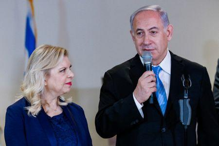 Israeli PM's wife charged with fraud, breach of trust