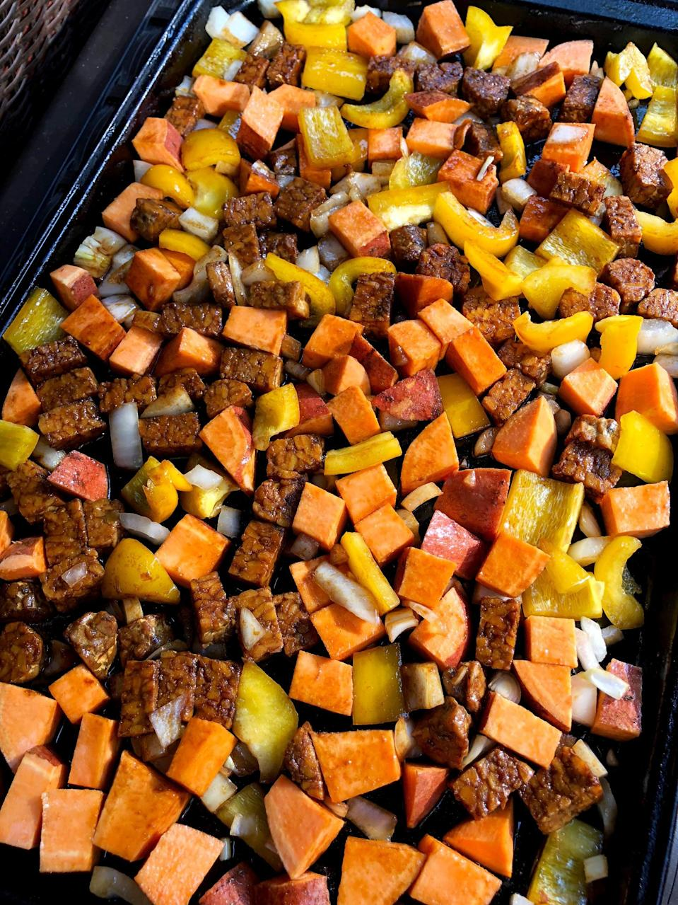 """<p>This one-pan meal is so easy and delicious, you'll want to add it to your weekly meal rotation. Look for a tempeh that's grain-free.</p> <p><strong>Get the recipe:</strong> <a href=""""https://www.popsugar.com/fitness/Roasted-Tempeh-Sweet-Potato-Pepper-1-Pan-Meal-45366372"""" class=""""link rapid-noclick-resp"""" rel=""""nofollow noopener"""" target=""""_blank"""" data-ylk=""""slk:maple-ginger roasted tempeh, sweet potato, pepper, and onion"""">maple-ginger roasted tempeh, sweet potato, pepper, and onion</a></p>"""