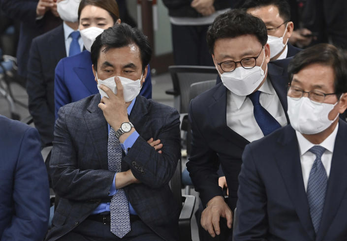 Members of South Korean ruling Democratic Party watch screens showing the result of exit polls of the Seoul mayoral by-election at the party headquarters Wednesday, April 7, 2021, in Seoul, South Korea. (Jung Yeon-je/Pool Photo via AP)