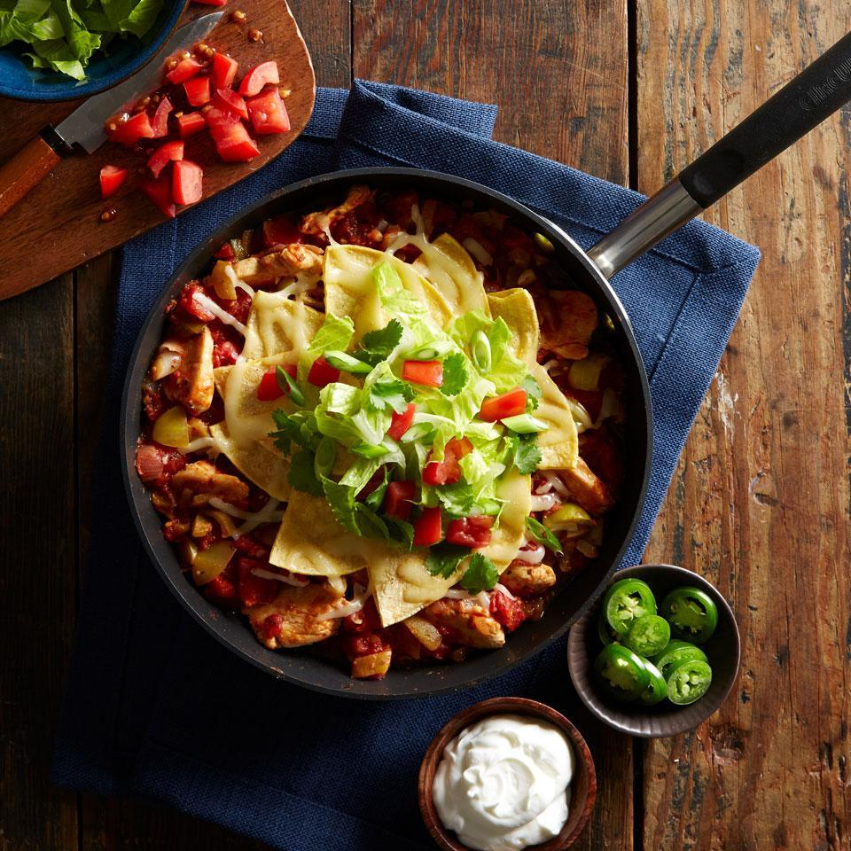 <p>This 45-minute enchilada recipe is bursting with chicken, tomatoes, tomatillos, chile peppers, and cheese, and because it's a one-skillet casserole, cleanup is a breeze.</p>