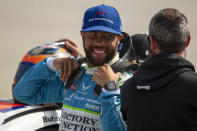 FILE - In this Oct. 5, 2019, file photo, Bubba Wallace gets ready to enter his car for qualifying rounds before a NASCAR Xfinity Series auto race in Dover, Del. Denny Hamlin is starting his own race car team in partnership with Charlotte Hornets owner Michael Jordan and Wallace as the driver. (AP Photo/Brien Aho, File)