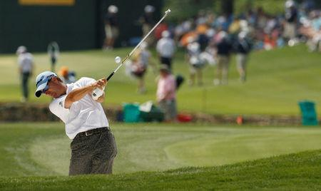 FILE PHOTO: Scott McCarron of the U.S. hits from the fairway bunker on the 18th hole during the third round of the Quail Hollow Championship in Charlotte, North Carolina May 1, 2010. REUTERS/Jason Miczek/File Photo