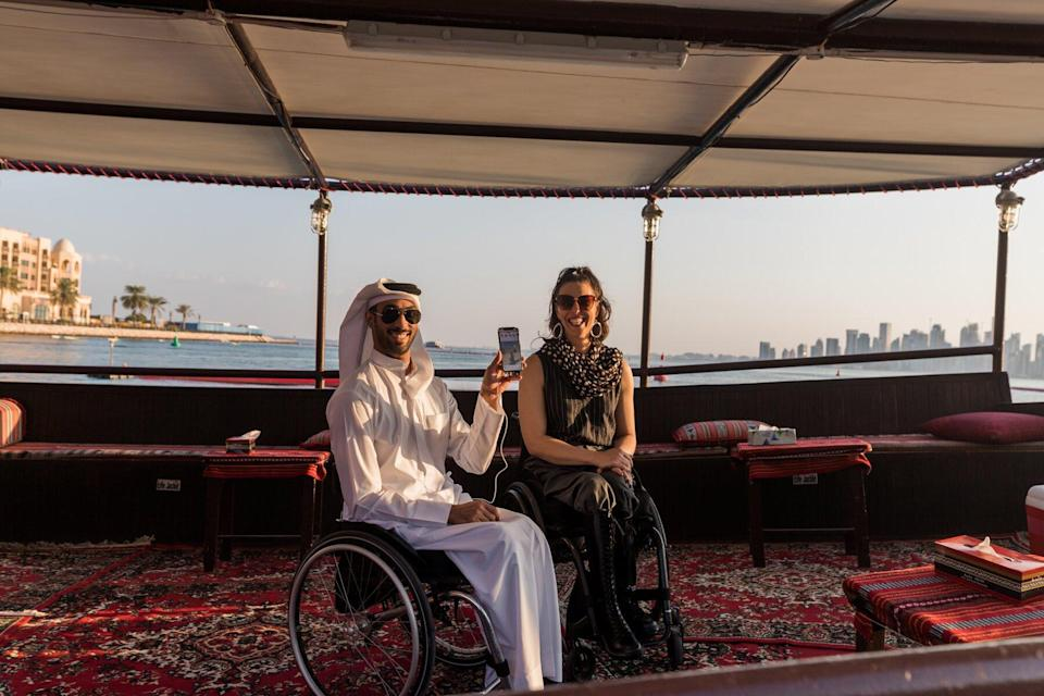 People in wheel chairs on a boat in Qatar