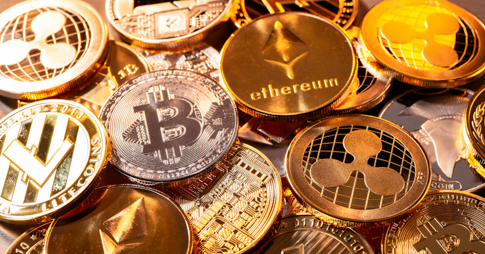 The depiction of the physical coins for various cryptocurrencies