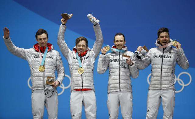 Medals Ceremony - Nordic Combined Events - Pyeongchang 2018 Winter Olympics - Men's Team 4 x 5 km - Medals Plaza - Pyeongchang, South Korea - February 23, 2018 - Gold medalists Vinzenz Geiger, Fabian Riessle, Eric Frenzel and Johannes Rydzek of Germany on the podium. REUTERS/Kim Hong-Ji