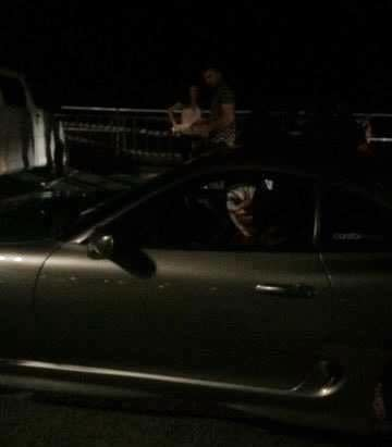 A clown sits in the passenger seat of a car, reportedly in Bondi. Photo: Facebook