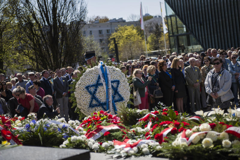 WARSAW, MAZOWIECKIE, POLAND - 2019/04/19: A soldier seen carrying a wreath during a ceremony to mark the 76th anniversary of the outbreak of the Warsaw Ghetto Uprising. As part of the ceremony alarm sirens were heard throughout the city to remember those who were murdered in the ghetto in 1943. The Warsaw ghetto uprising was a violent revolt that occurred from April 19 to May 16, 1943, during World War II. Residents of the Jewish ghetto in Nazi-occupied Warsaw, Poland, staged the armed revolt to prevent deportations to Nazi-run extermination camps. (Photo by Attila Husejnow/SOPA Images/LightRocket via Getty Images)