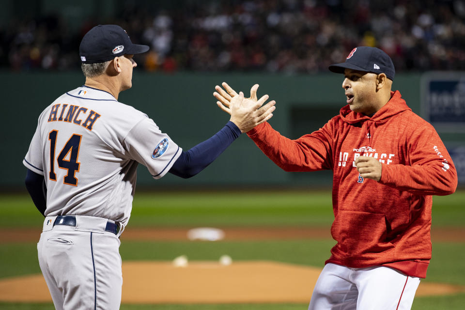 BOSTON, MA - OCTOBER 13: Manager Alex Cora of the Boston Red Sox high fives manager A.J. Hinch of the Houston Astros before game one of the American League Championship Series on October 13, 2018 at Fenway Park in Boston, Massachusetts. (Photo by Billie Weiss/Boston Red Sox/Getty Images)