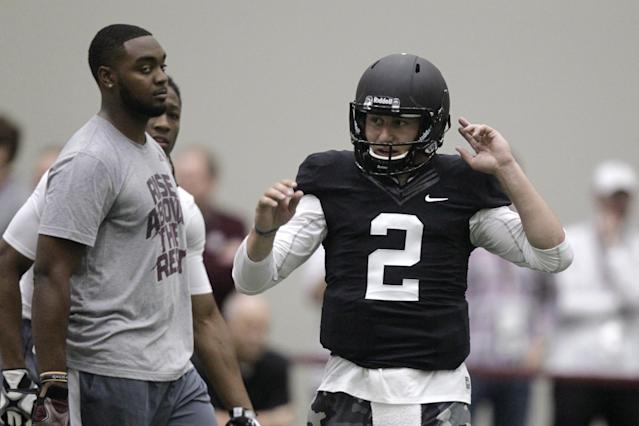 Texas A&M quarterback Johnny Manziel prepares to perform drills at pro day for NFL football representatives in College Station, Texas, Thursday, March 27, 2014. (AP Photo/Patric Schneider)