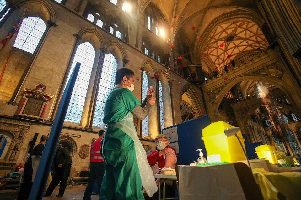 The Pfizer coronavirus vaccine being prepared by Doctor Den Kay at Salisbury Cathedral before being administered to a patientPA