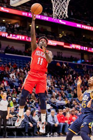 FILE PHOTO: Mar 6, 2019; New Orleans, LA, USA; New Orleans Pelicans guard Jrue Holiday (11) shoots the ball in front of Utah Jazz guard Donovan Mitchell (45) during the first half at Smoothie King Center. Stephen Lew/File Photo