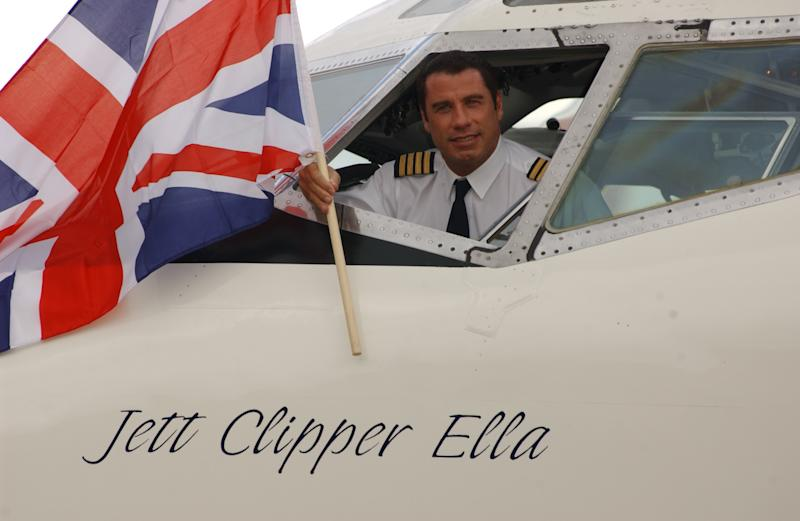 As part of his Spirit of Friendship Tour, John Travolta flies his own former Qantas Boeing 707 to Heathrow airpor having recently completed his 747-400 simulator training in Seattle. The Friendship Tour is set to go to Rome, Paris, Frankfurt and New York before returning to Los Angeles. (Photo by rune hellestad/Corbis via Getty Images)
