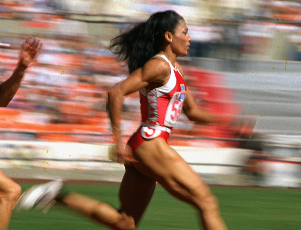 FILE - In this Sept. 29, 1988, file photo, U.S. sprinter Florence Griffith Joyner of Los Angeles strides to a world record in a semifinal heat of the Olympic women's 200-meter dash in Seoul, South Korea. The name Flo-Jo is popping up quite a bit these days with sprinters creeping closer to her record times in the women's 100 and 200 races. The late Florence Griffith Joyner has held both marks for three decades. (AP Photo/Lennox McLendon, File)