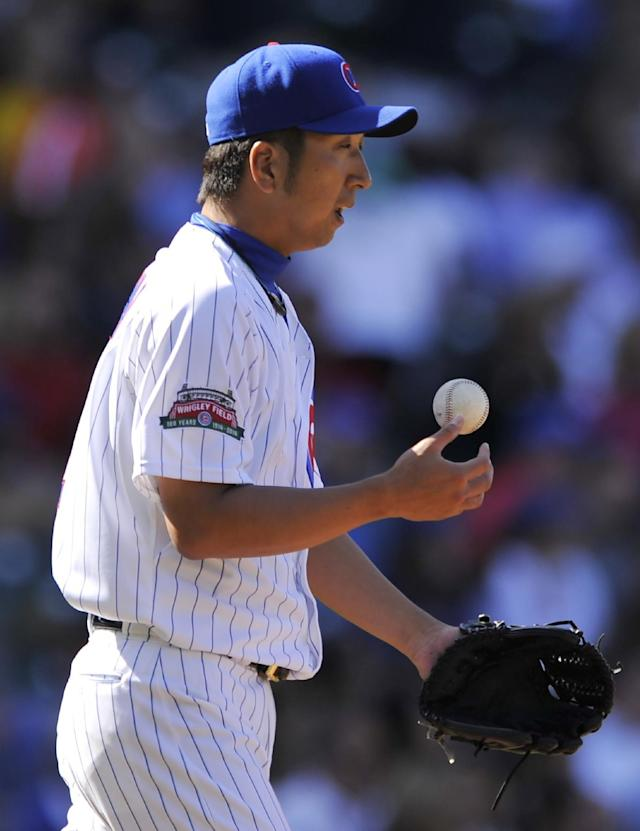 Chicago Cubs relief pitcher Kyuji Fujikawa of Japan, reacts after Milwaukee Brewers' Mark Reynolds hit a solo home run during the eighth inning of a baseball game in Chicago, Thursday, Aug. 14, 2014. (AP Photo/Paul Beaty)