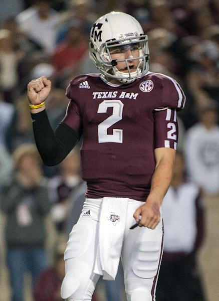 Texas A&M quarterback Johnny Manziel reacts after a touchdown run by teammate Ben Malena during the first quarter an NCAA college football game against Missouri, Saturday, Nov. 24, 2012, in College Station, Texas. (AP Photo/Dave Einsel)