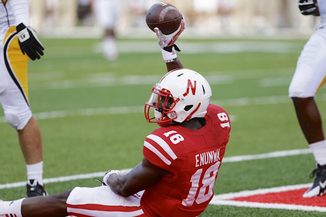 Nebraska wide receiver Quincy Enunwa (18) holds up the ball after scoring a touchdown against Southern Mississippi in the first half of an NCAA college football game in Lincoln, Neb., Saturday, Sept. 7, 2013. (AP Photo/Nati Harnik)