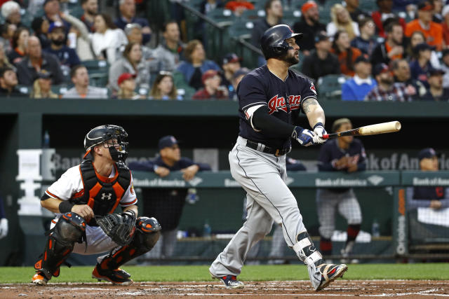 Cleveland Indians' Yonder Alonso, right, watches his two-run home run in front of Baltimore Orioles catcher Chance Sisco in the second inning of a baseball game, Monday, April 23, 2018, in Baltimore. (AP Photo/Patrick Semansky)