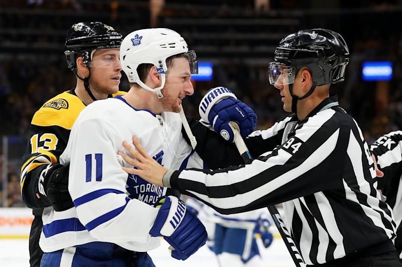 BOSTON, MASSACHUSETTS - APRIL 19: Zach Hyman #11 of the Toronto Maple Leafs is separated from Zdeno Chara #33 of the Boston Bruins by linesman Bryan Pancich #94 during the second period of Game Five of the Eastern Conference First Round during the 2019 NHL Stanley Cup Playoffs at TD Garden on April 19, 2019 in Boston, Massachusetts. (Photo by Maddie Meyer/Getty Images)