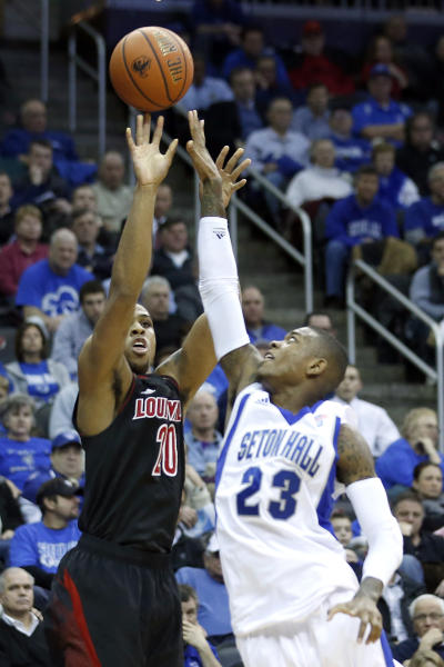 Louisville's Wayne Blackshear (20) shoots as Seton Hall guard/forward Fuquan Edwin (23) defends during the first half of an NCAA college basketball game on Wednesday, Jan. 9, 2013, in Newark, N.J. (AP Photo/Julio Cortez)