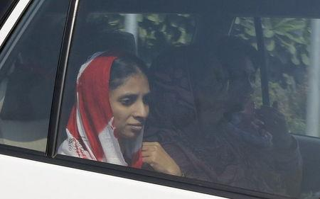 Geeta sits inside a car as she leaves after her arrival at an airport in New Delhi, India, October 26, 2015. REUTERS/Adnan Abidi