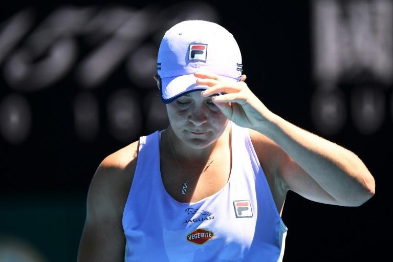 Open exit: Ashleigh Barty on her way to quarter-final defeat against Karolina Muchova