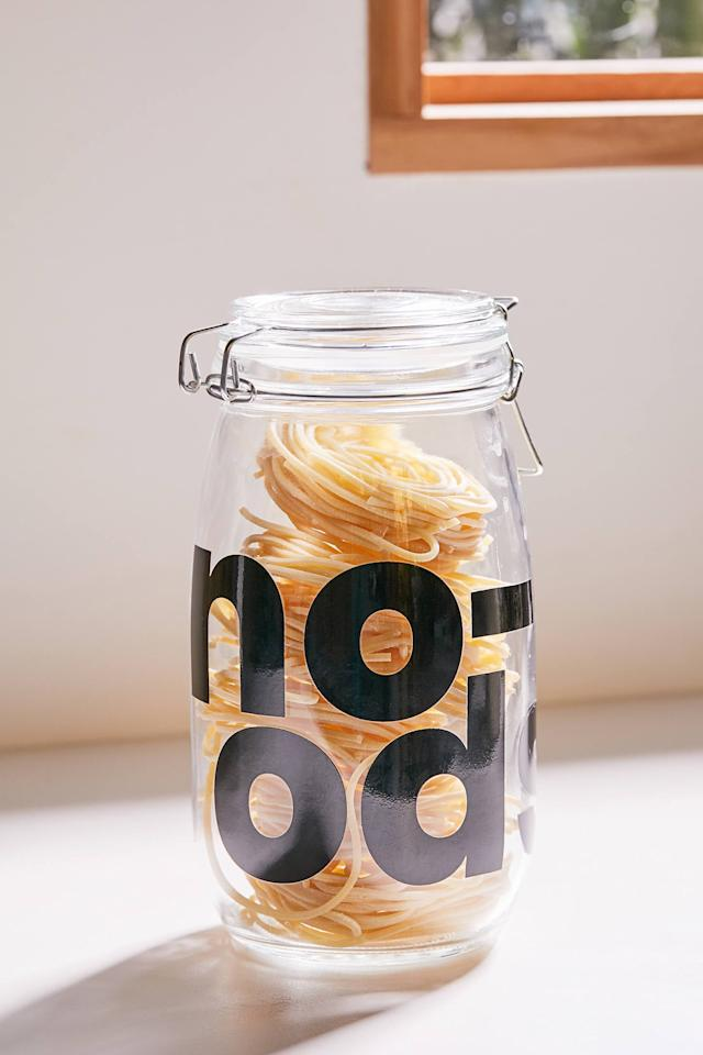 """<p>There are many versions of this <a href=""""https://www.popsugar.com/buy/Large-Clipped-Glass-Storage-Jar-476999?p_name=Large%20Clipped%20Glass%20Storage%20Jar&retailer=urbanoutfitters.com&pid=476999&price=12&evar1=yum%3Aus&evar9=46470696&evar98=https%3A%2F%2Fwww.popsugar.com%2Ffood%2Fphoto-gallery%2F46470696%2Fimage%2F46471134%2FLarge-Clipped-Glass-Storage-Jar&list1=shopping%2Curban%20outfitters%2Ckitchen%20tools%2Ckitchens%2Ckitchen%20accessories&prop13=mobile&pdata=1"""" rel=""""nofollow"""" data-shoppable-link=""""1"""" target=""""_blank"""" class=""""ga-track"""" data-ga-category=""""Related"""" data-ga-label=""""https://www.urbanoutfitters.com/shop/large-clipped-glass-storage-jar?category=dinnerware&amp;color=100&amp;quantity=1&amp;size=L&amp;type=REGULAR"""" data-ga-action=""""In-Line Links"""">Large Clipped Glass Storage Jar</a> ($12).</p>"""