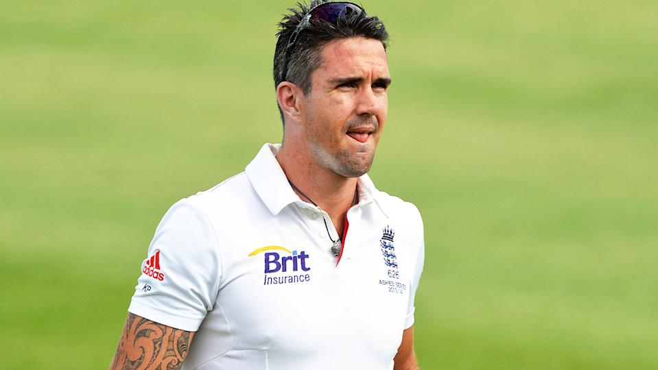 Kevin Pietersen (pictured) carrying drinks and a helmet out to teammates.