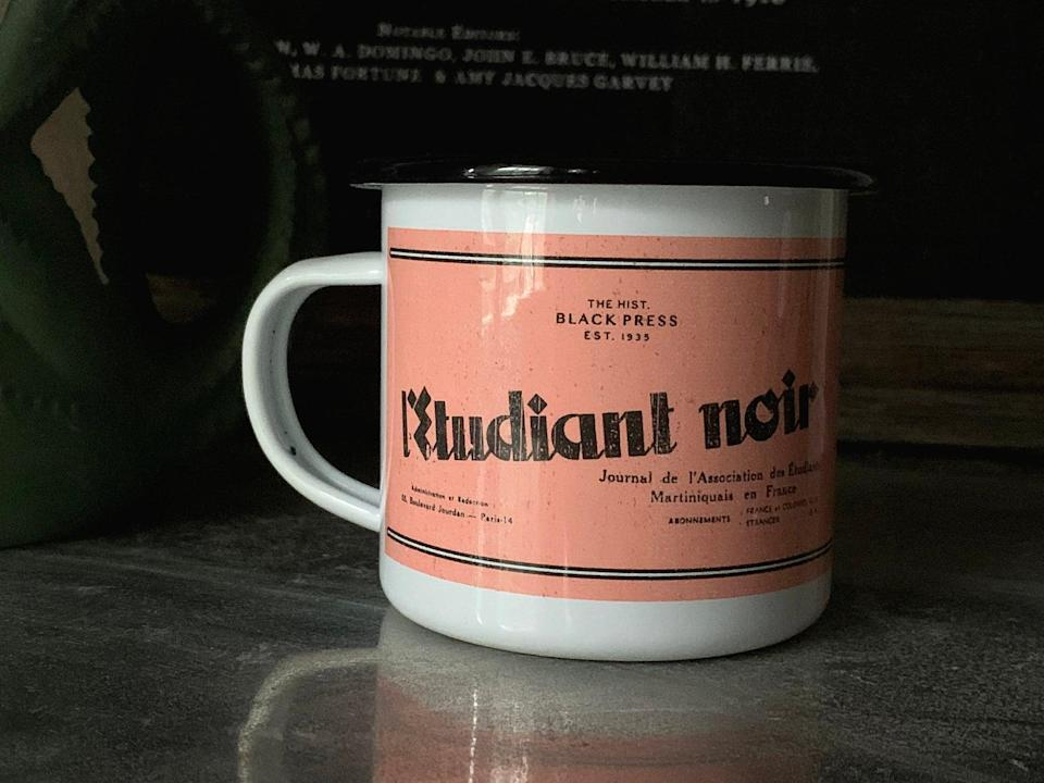 """<p>This <span>Historic Black Newspapers L'Étudiant Noir Mug</span> ($32) features L'Étudiant noir (The Black Student), a Black-owned and operated newspaper journal created in 1935 in Paris.</p> <p>According to Etsy seller DontSleepInteriors, """"L'Étudiant noir was created for the founding of the Negritude movement a pro-Black, literary and philosophical movement inspired by the Harlem Renaissance. The Negritude movement focused on uniting Black people across the world to fight against white oppression and colonialism.""""</p>"""