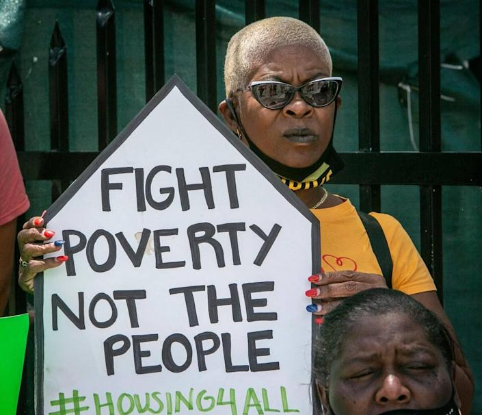 Frederica Dawson holds a sign in protest outside Elena Riech's house in Allapattah on June 8, 2021. Riech is a single mother of three in danger of being evicted even though she qualified for governmental assistance.