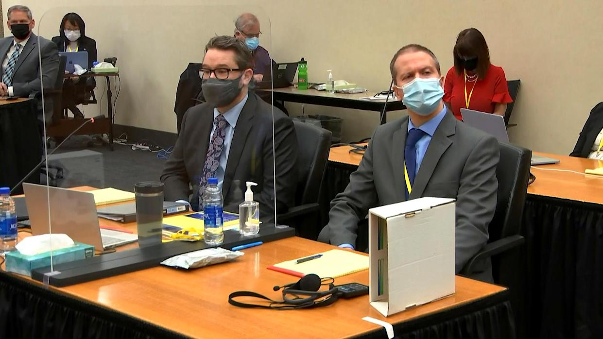 IMAGE: Defense attorney Eric Nelson and Derek Chauvin in court (Pool via NBC News)