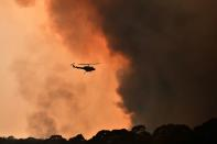 A helicopter is seen during a bushfire near Bilpin