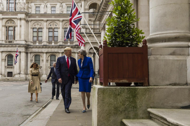 President Donald Trump walks with British Prime Minister Theresa May, followed by first lady Melania Trump, and Philip May, to a news conference at the Foreign Office, Tuesday, June 4, 2019, in central London. (AP Photo/Alex Brandon)