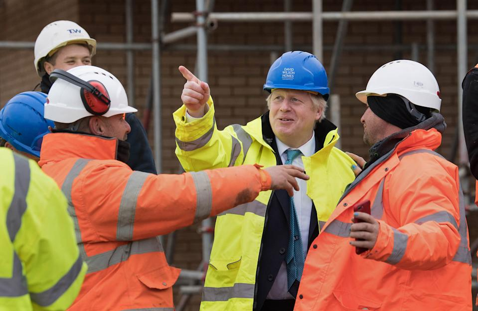 Prime Minister Boris Johnson (2nd right) during a visit to David Wilson Homes in Bedford while on the campaign trail for the General Election.