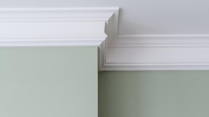 Ceiling moldings in the interior, a detail of intricate corner.